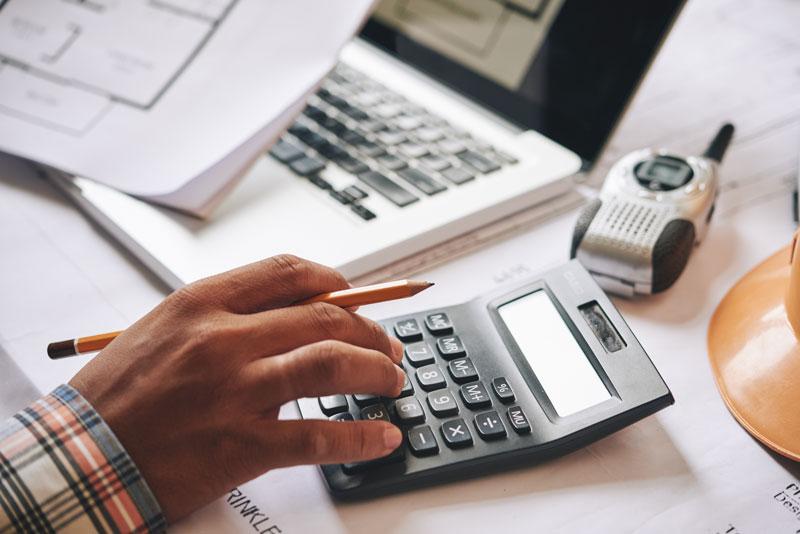 Person using calculator in project estimate